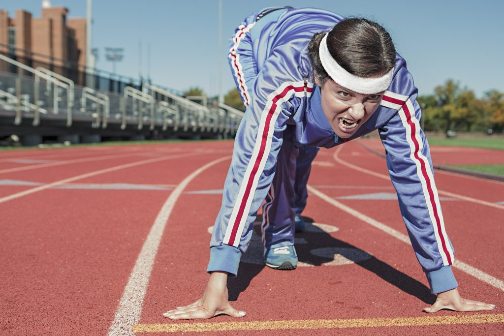 woman running, f45, f45 challenge, running, track, anger, determination